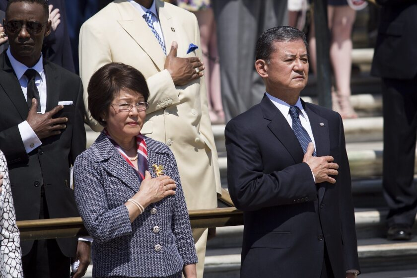 Veterans Affairs Secretary Eric Shinseki and his wife, Patricia, attend a Memorial Day wreath-laying ceremony in Arlington, Va.