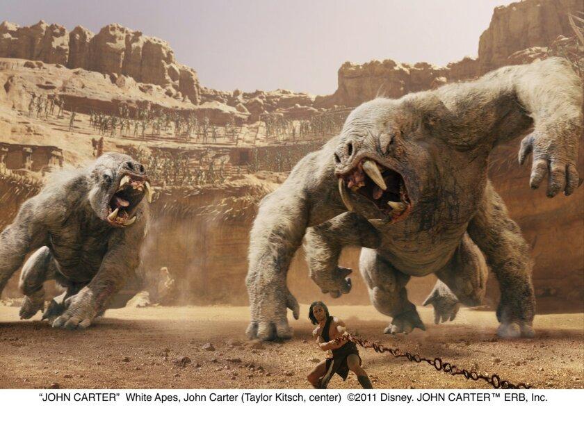"""John Carter (Taylor Kitsch) battles the white apes in """"John Carter."""" ©2011 Disney."""