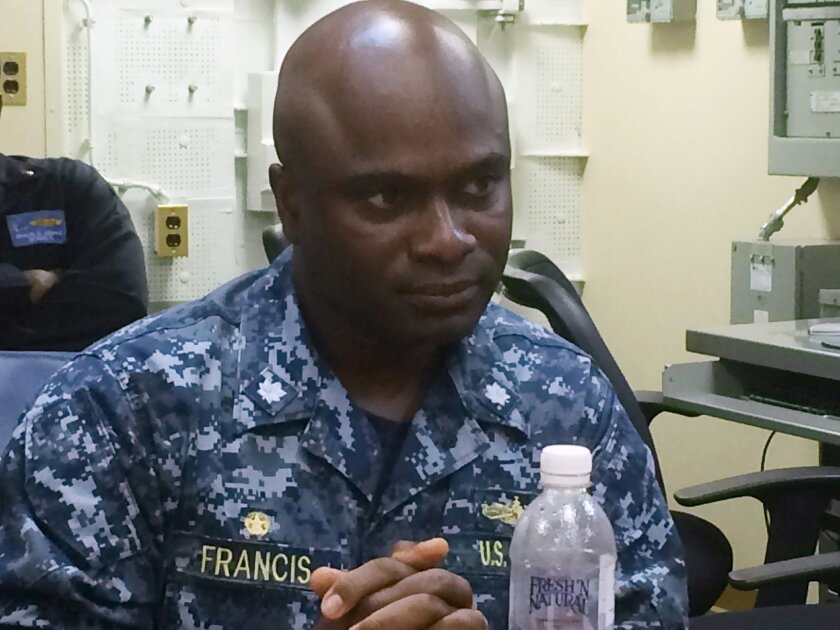 Cmdr. Robert Francis Jr., skipper of the USS Lassen, speaks to a reporter Thursday, Nov. 5, 2015, aboard the USS Theodore Roosevelt in the South China Sea. A week earlier, the USS Lassen challenged China's claim to a 12-mile territorial limit around Subi Reef in the Spratly Islands about 150 miles