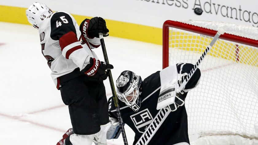 Arizona Coyotes forward Josh Archibald (45) jumps next to Los Angeles Kings goalie Cal Petersen (40)
