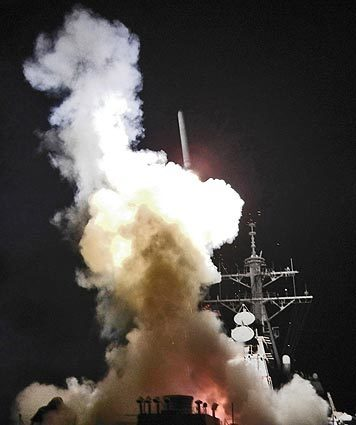 The U.S. Navy's destroyer Barry launches a Tomahawk missile toward Libya from the Mediterranean Sea. U.S. and British warships fired 110 Tomahawk missiles and French fighter jets hits Libyan military targets.