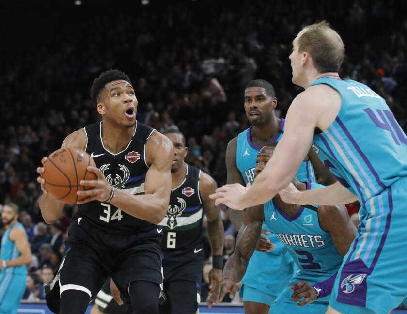 The Bucks' Giannis Antetokounmpo drives against the Hornets' Cody Zeller on Jan. 24, 2020, in Paris.