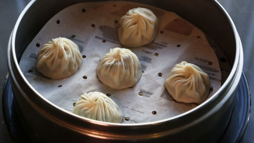 GLENDALE, CA. - DECEMBER 16, 2013: Truffle dumplings for Jonathan Gold food review of Din Tai Fung