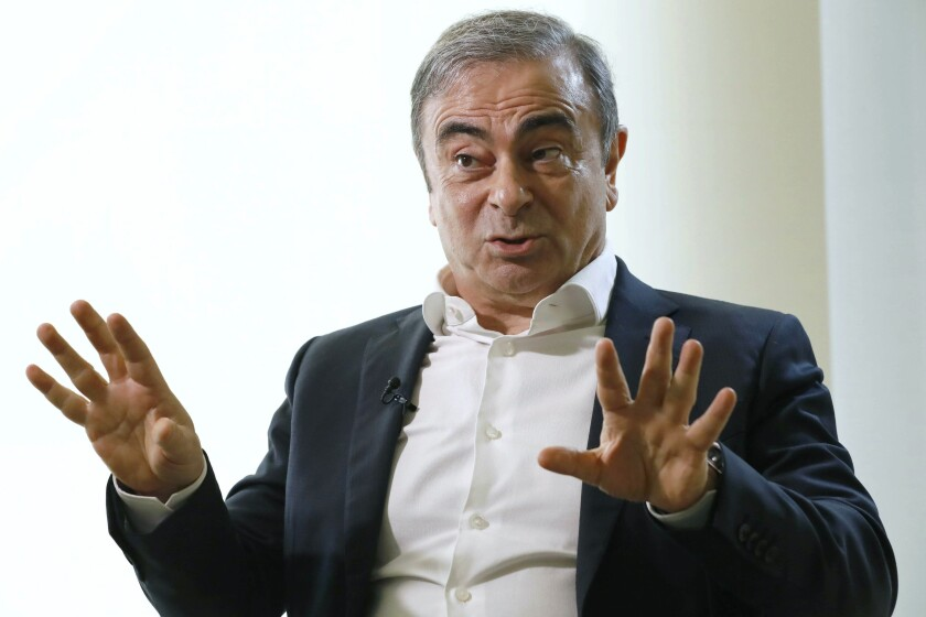 FILE - In this Jan. 10, 2020, file photo, former Nissan Chairman Carlos Ghosn speaks to Japanese media during an interview in Beirut, Lebanon. Prosecutors filed documents on Tuesday, July 7, 2020, detailing wire transfers by Ghosn to a company linked to one of the men accused of helping smuggle him out of Japan in a box in 2019. (Meika Fujio/Kyodo News via AP)