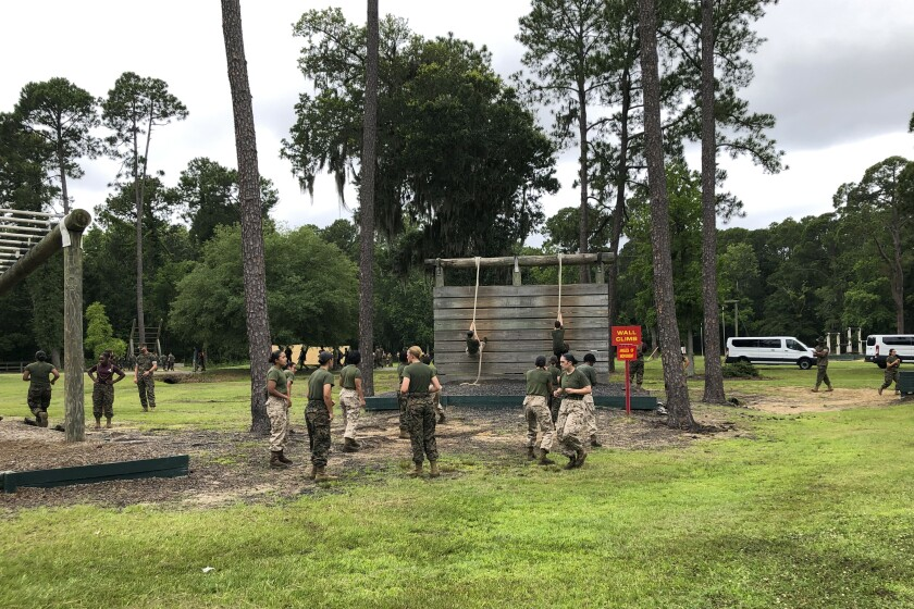Female Marines go through one of the obstacles in the so-called confidence course at Parris Island Recruit Depot, S.,C., on May 27, 2020, that is designed to make them face their fears and gain confidence. In ways big and small, the virus is impacting training at the Marine Corps' Parris Island Recruit Depot and across the military. (AP Photo/Lolita Baldor)