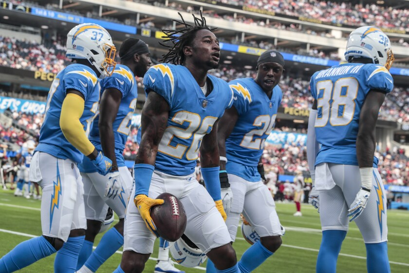 Chargers cornerback Asante Samuel Jr. (26) celebrates with teammates after an interception against the 49ers