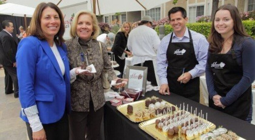 Susan Hendrickson and Jane Lahre with Matt Gehring and Anna Ondik from Shari's Berries