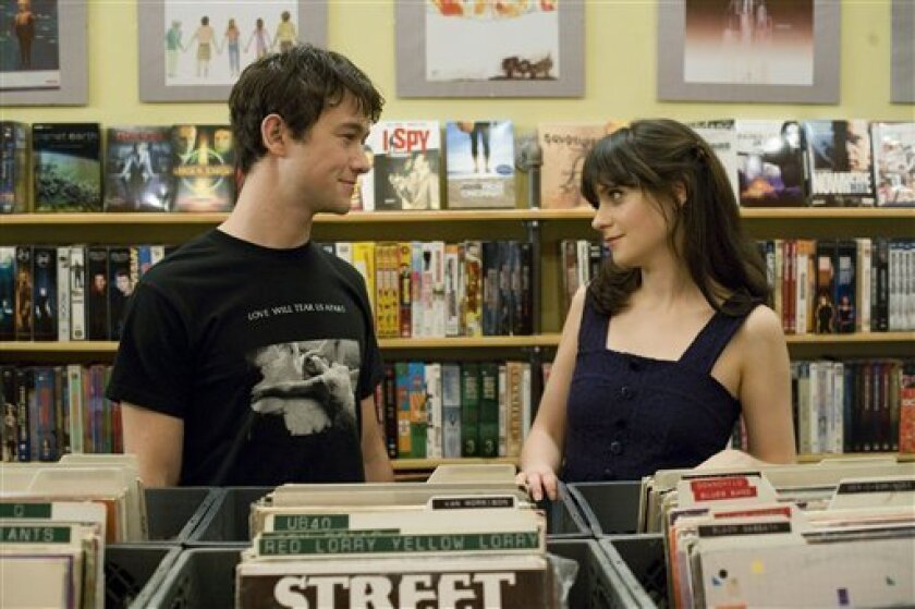 "In this film publicity still released by Fox Searchlight, Joseph Gordon-Levitt, left, and Zooey Deschanel are shown in a scene from ""500 Days of Summer."" (AP Photo/Fox Searchlight, Chuck Zlotnick)"
