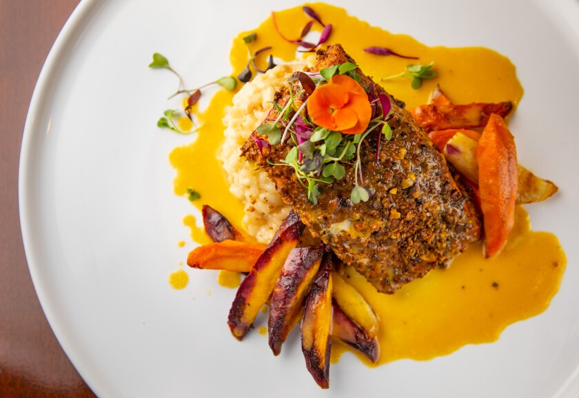 Chef Alicia Kolk's pistachio-crusted salmon, with fennel risotto and grilled orange beurre blanc, is an elevated dish that helped get her head chef position.