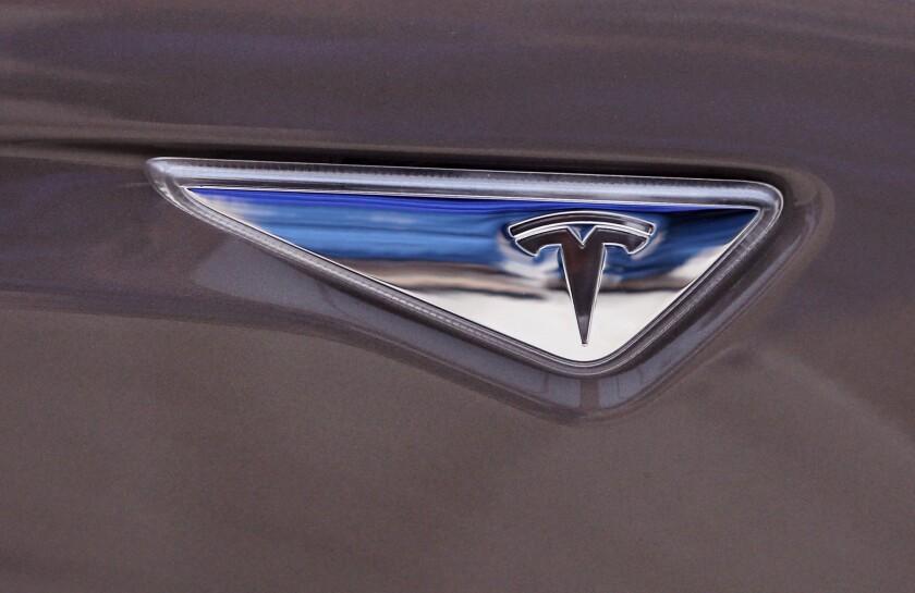 The Tesla logo on a Tesla Model S 70D