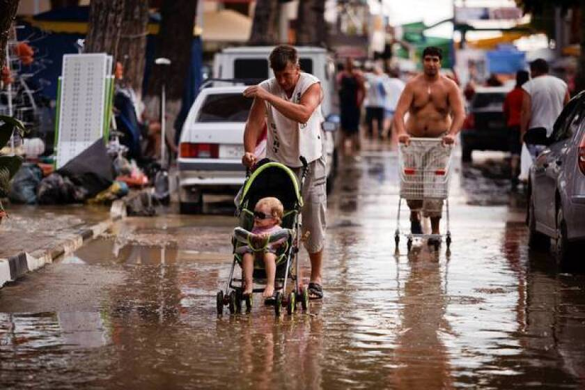 Streets are muddy after flooding in the the Black Sea resort of Gelendzhik, Russia.