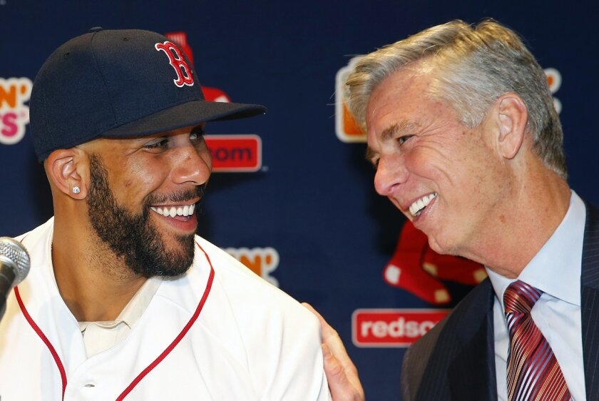 Boston Red Sox pitcher David Price, left, smiles at president of baseball operations Dave Dombrowski during a news conference announcing his signing by the teamat Fenway Park in Boston, Friday, Dec. 4, 2015. (AP Photo/Winslow Townson)