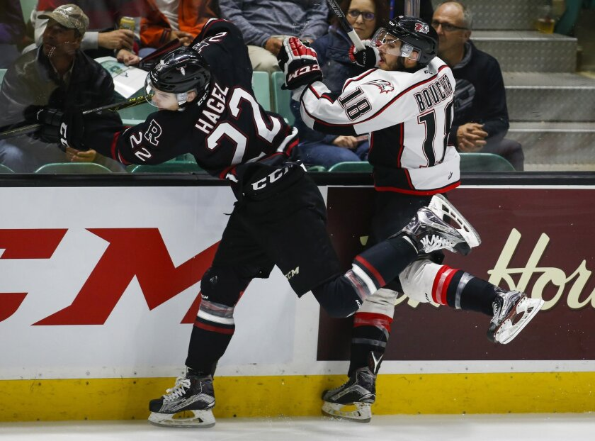 Rouyn-Noranda Huskies' Mathieu Boucher, right, is checked by Red Deer Rebels' Brandon Hagel during the first period of a CHL Memorial Cup hockey game Friday, may 27, 2016, in Red Deer, Alberta. (Jeff McIntosh/The Canadian Press via AP)