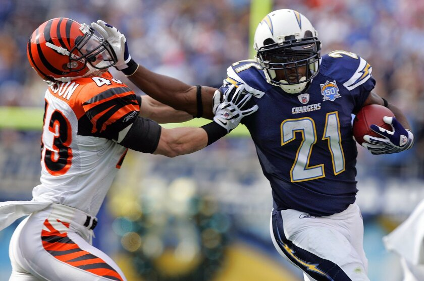 Chargers LaDainian Tomlinson stiff arms Bengals Tom Nelson during a 2009 game.