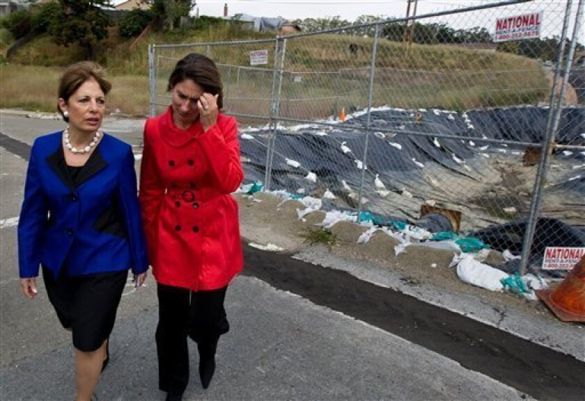 National Transportation Safety Board Chair Deborah Hersman, right, and U.S. Rep. Jackie Speier, D-San Mateo, walk past an area where a ruptured gas line caused a deadly pipeline explosion nearly nine months ago, in San Bruno, Calif., Wednesday, June 8, 2011. Officials are still probing the cause of the explosion, which engulfed a San Bruno neighborhood and killed eight people, injured dozens, and destroyed 38 homes. (AP Photo/Darryl Bush)