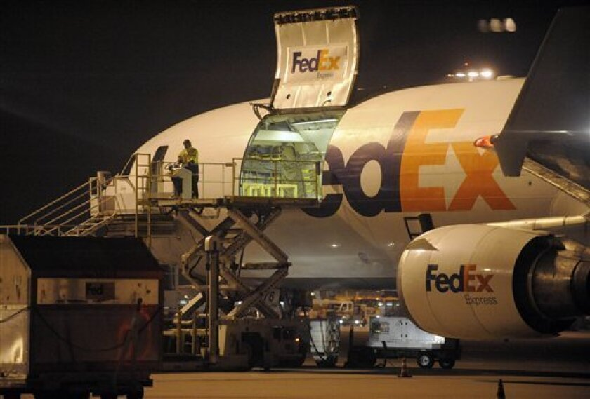 A cargo plane is loaded at the FedEx distribution center at the International Cargo Airport in Cologne, western Germany, Monday Nov. 1, 2010. After intercepting two mail bombs addressed to Chicago-area synagogues, investigators found out that packages that terrorists in Yemen attempted to smuggle onto an aircraft in a brazen al-Qaida terror plot, were moved through Cologne. (AP Photo/Martin Meissner)