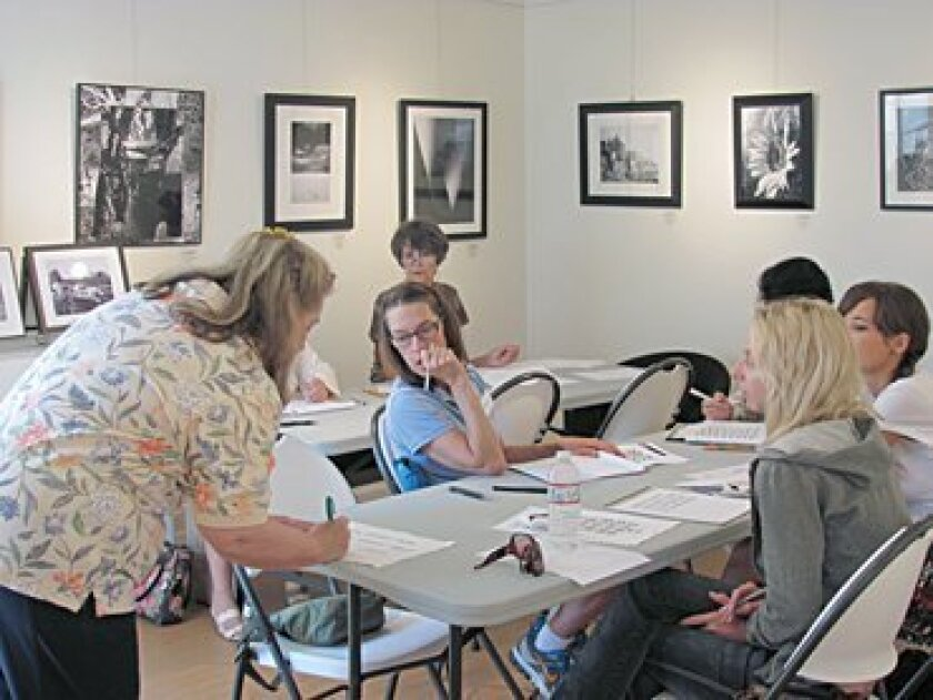 Artist Sharon Ford teaches a calligraphy class at the La Jolla Art Association galleries Oct. 2. Photo: Susan DeMaggio