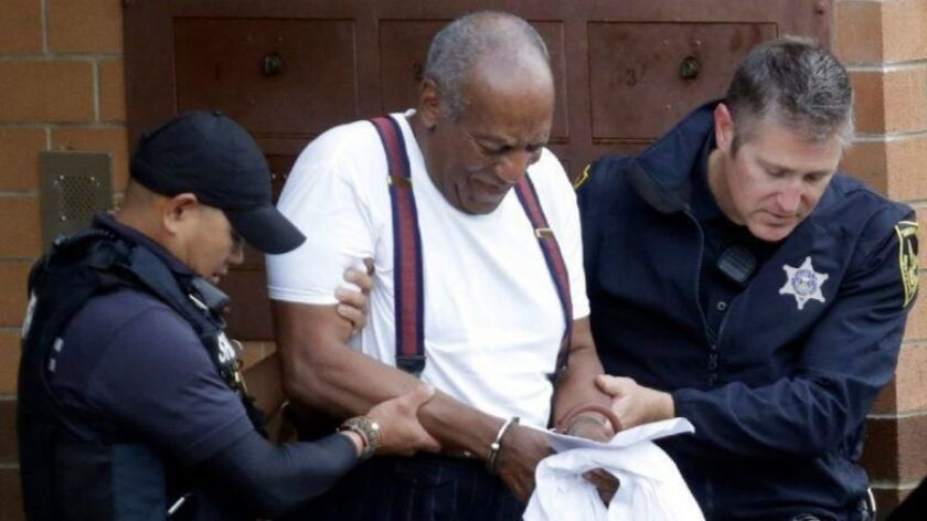Bill Cosby is led away in handcuffs after he was sentenced to three to 10 years in prison on Sept. 25.