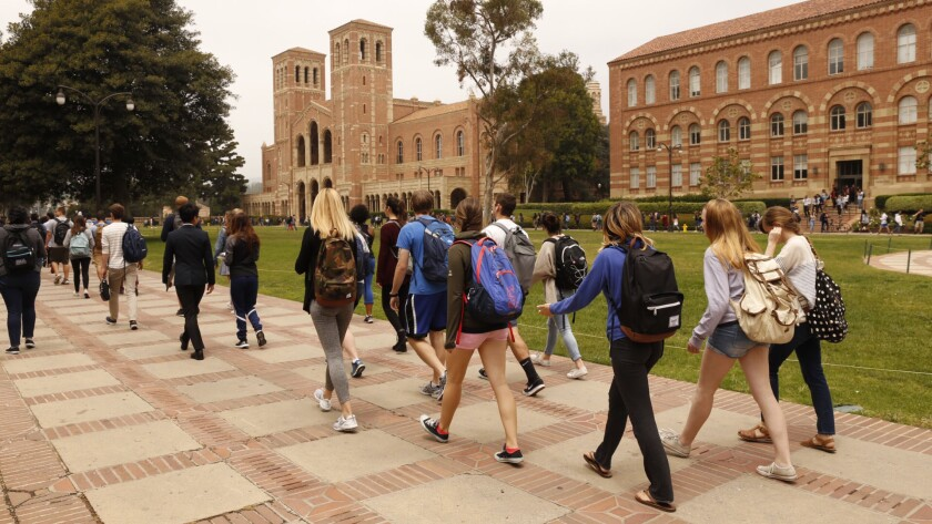 Students return to campus Wednesday after a shooting at UCLA.