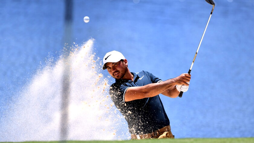 Jason Day hits out of a bunker during the third round of the Australian Open on Friday.