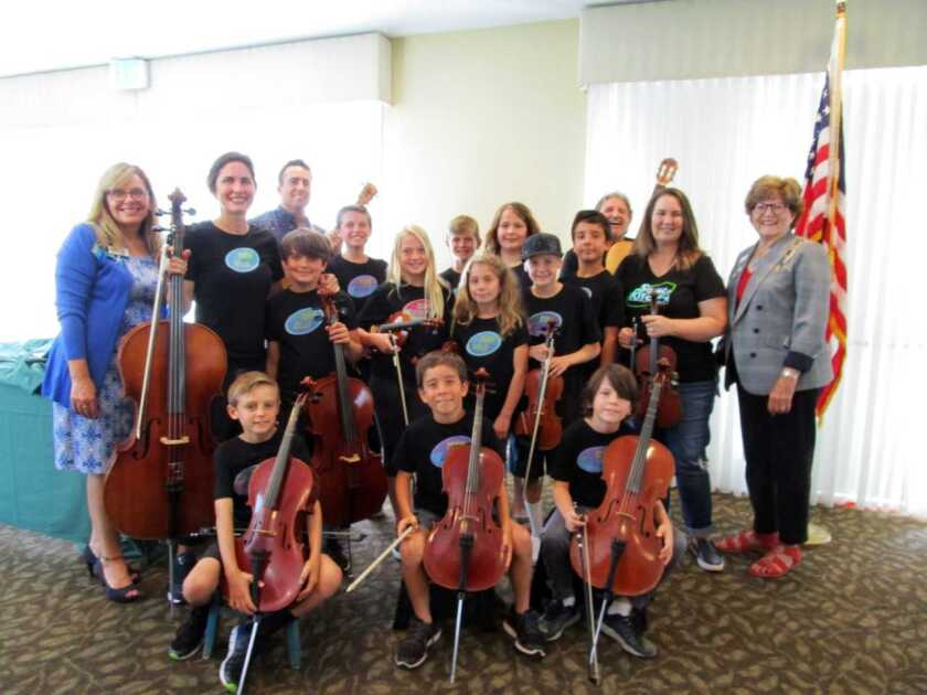 The Carlsbad-based Team Violin and Team Cello performed for the Santa Margarita Chapter, Daughters of the American Revolution. The group of young musicians played patriotic as well as Billboard chart songs. Regent Charla Boodry and Vice Regent Laura Horn presented the group with a certificate and honorarium. Pictured are Team Violin and Team Cello members with Horn (left), Bridget Dolkas, leader of Team Violin-Team Cello orchestra, and Boodry (right). DAR is open to women ages 18 and older lineally descended from a patriot who assisted the colonists in the American Revolution. Visit santamargarita.californiadar.org.
