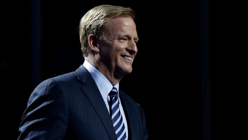 Commissioner Roger Goodell smiles as he walks onstage during the first round of the NFL draft on April 27.