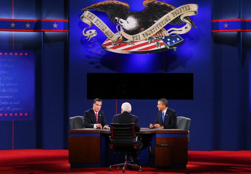President Obama debates with Republican presidential candidate Mitt Romney as moderator Bob Schieffer looks on at Lynn University in Boca Raton, Fla.