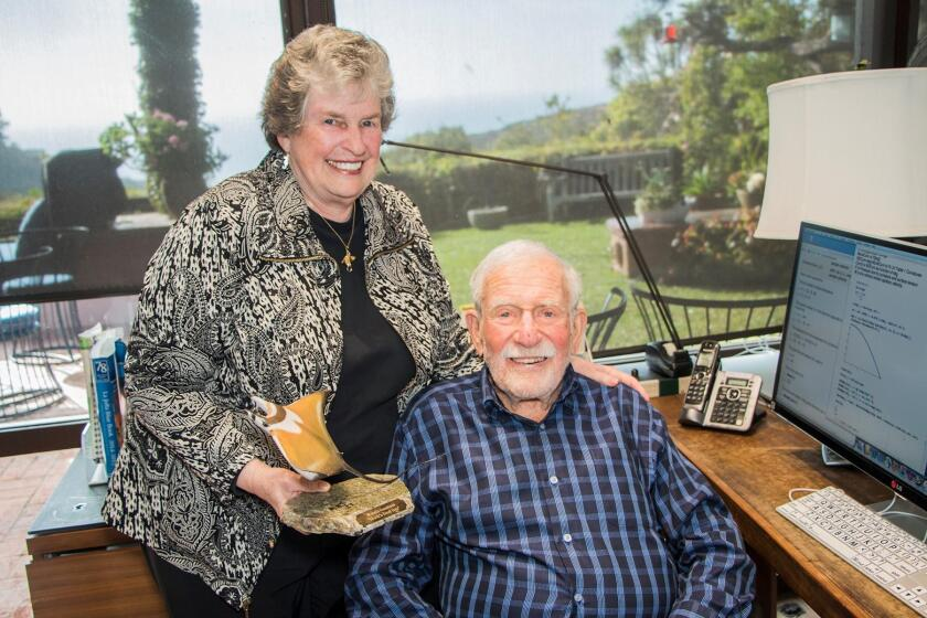 Mary and Walter Munk, with a small model Mobula Munkiana, also known Munk's devil fish