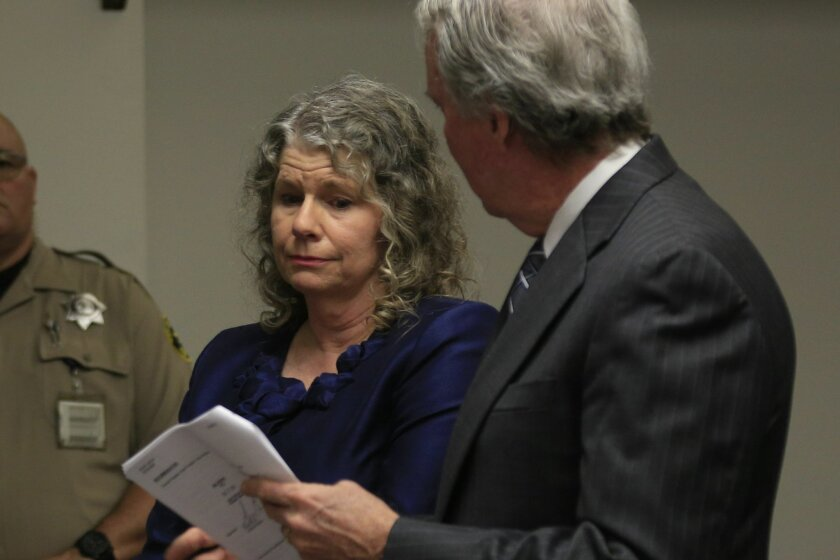 Kathy Rowe stands beside her attorney Brad Patton as she is sentenced to five years probation and 10 years no contact after being convicted of solicitation of rape in a case where she terrorized a family because they purchased a home she wanted. She posted the name of the woman of the home on a web