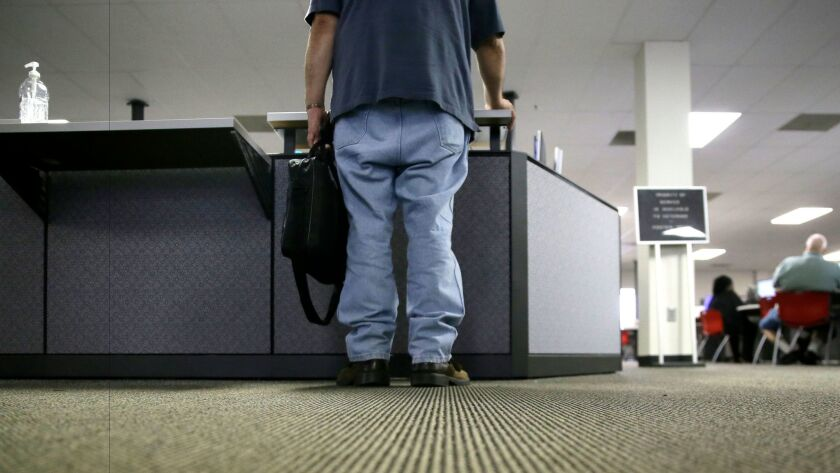 A job seeker checks in at the front desk of the Texas Workforce Solutions office in Dallas on March 10.