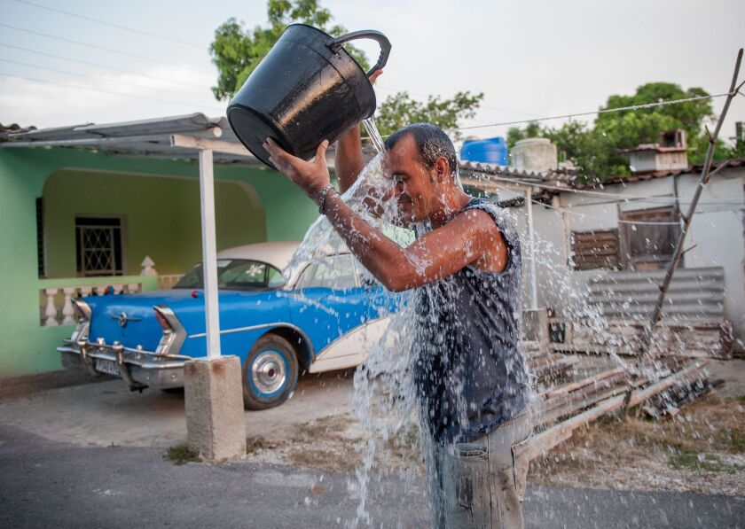 A Cuban man refreshes himself during a summer heat wave in Havana last month.