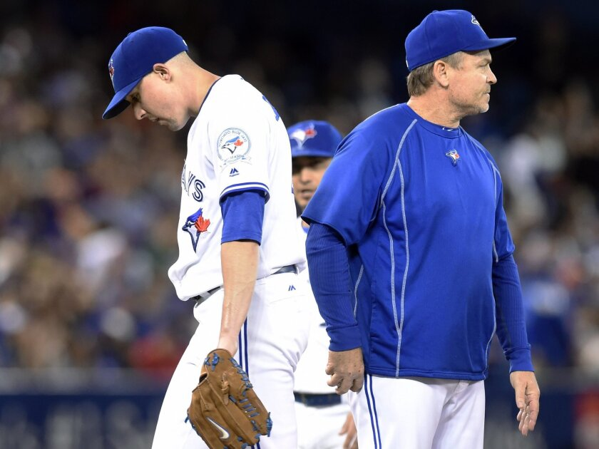 Toronto Blue Jays manager John Gibbons, right, takes pitcher Aaron Sanchez out of the game during the seventh inning of a baseball game against the New York Yankees, Wednesday, June 1, 2016, 2016 in Toronto. (Frank Gunn/The Canadian Press via AP) MANDATORY CREDIT