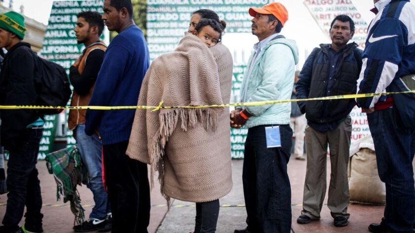 Immigrant Caravan Members Gather At U.S.-Mexico Border