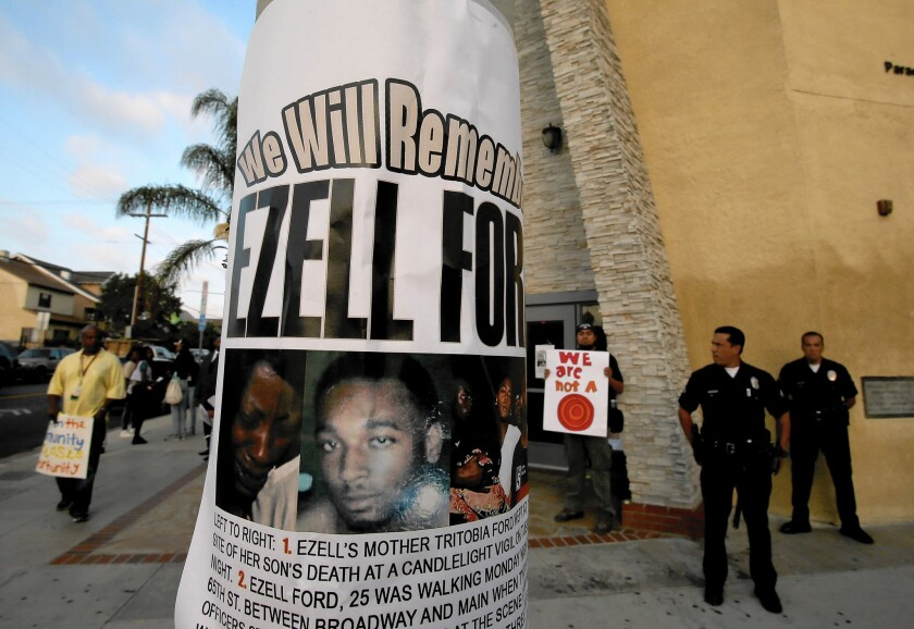 A flier with Ezell Ford Jr.'s image hangs on a post outside Paradise Baptist Church in South Los Angeles. Mayor Eric Garcetti ordered the LAPD to release the results of an autopsy on Ford, who was killed by police.