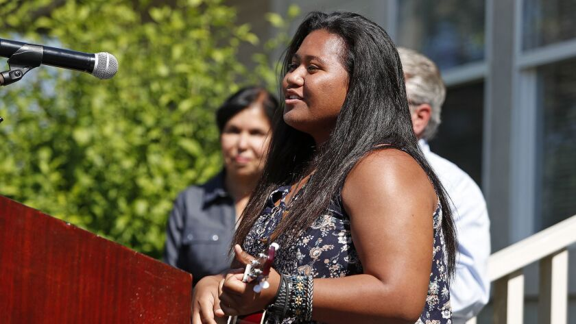 Former resident Martha Misikei, 18, of Anaheim strums her ukulele as she sings her self written song