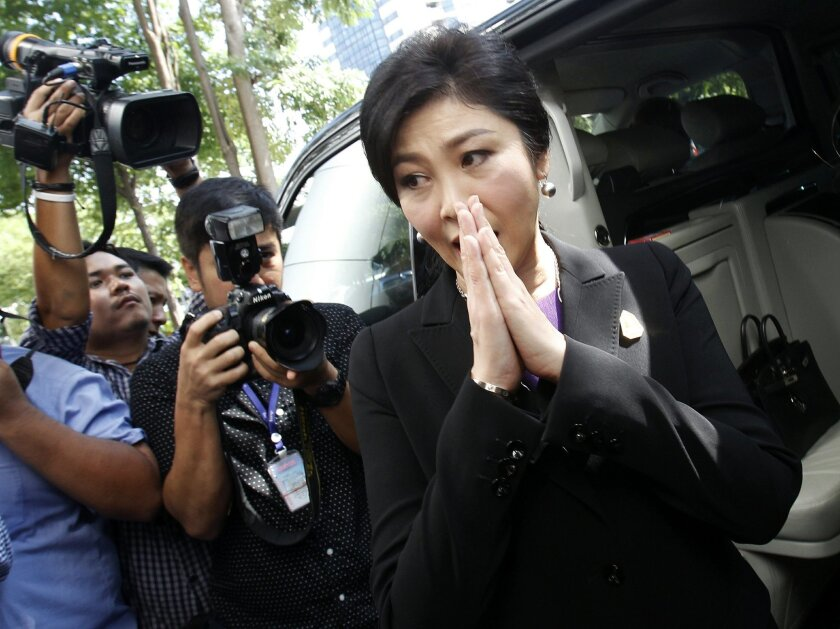 Thailand's former Prime Minister Yingluck Shinawatra leaves Bangkok's Criminal Court, Thailand, Tuesday, Sept. 29, 2015. Yingluck filed a criminal case at the court to counter-sue the country's attorney-general over the handling of her prosecution in connection with a subsidy scheme for rice farmers, which ran up huge losses. (AP Photo/Sakchai Lalit)