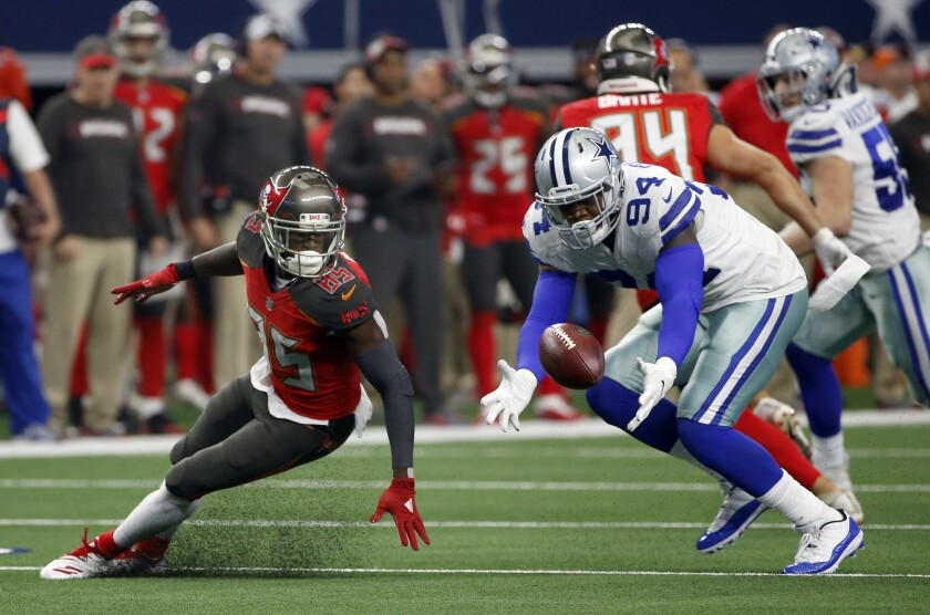 FILE - In this Dec. 23, 2018, file photo, Tampa Bay Buccaneers wide receiver Bobo Wilson (85) watches as Dallas Cowboys defensive end Randy Gregory (94) recovers a fumble in the second half of an NFL football game in Arlington, Texas. Gregory was conditionally reinstated by the NFL on Friday, Sept. 4, 2020, ending his fourth suspension over substance-abuse violations. (AP Photo/Ron Jenkins, File)