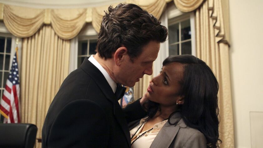 """President Fitzgerald Grant (Tony Goldwyn) and Olivia Pope (Kerry Washington) share an intimate moment alone in the Oval Office in the """"Scandal"""" series premiere."""