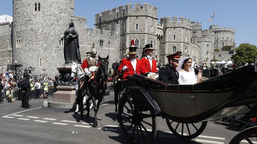 Britain's Prince Harry and Meghan Markle leave Windsor Castle after their wedding ceremony on May 19, 2018.