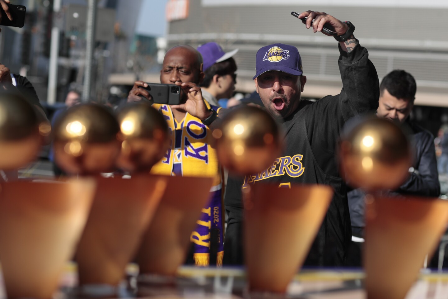 LOS ANGELES, CA, MONDAY, FEBRUARY 24, 2020 - Richard Miranda of Baldwin Park delivers a Kobe! chant as he views a diorama dedicated to the fallen Laker near Staples Center. (Robert Gauthier/Los Angeles Times)