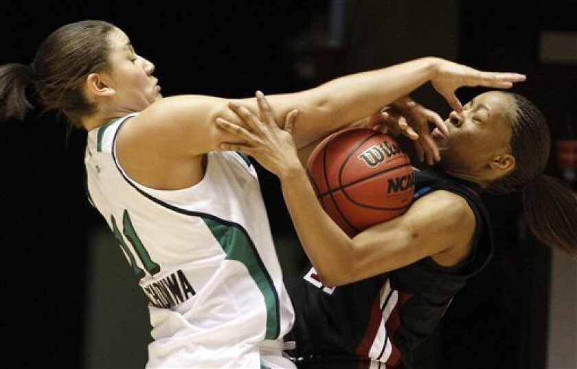 Notre Dame forward Natalie Achonwa (11), left, and Temple guard Shey Peddy (11) fight for a loose ball during the first half of their second-round game of the NCAA women's college basketball tournament Monday, March 21, 2011, in Salt Lake City. (AP Photo/Jim Urquhart)