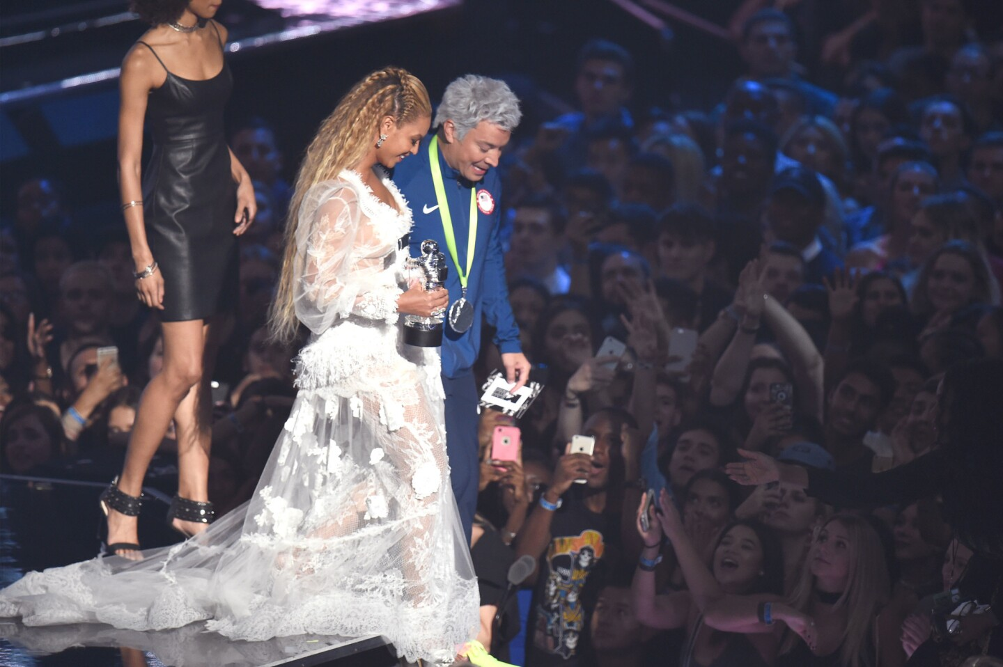 "Jimmy Fallon, as Olympian swimmer Ryan Lochte, helps Beyoncé walk in her dress after presenting her with video of the year for ""Formation"" onstage during the 2016 MTV Video Music Awards at Madison Square Garden in New York."
