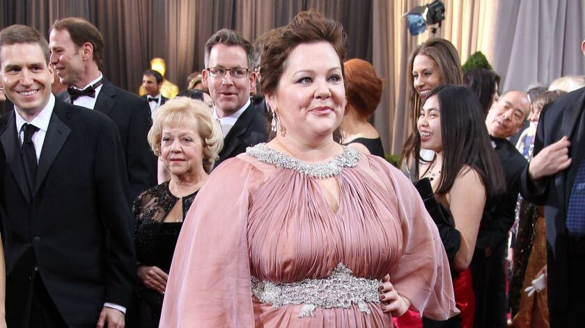 Melissa McCarthy poses on the red carpet at the 2012 Academy Awards. At the time, McCarthy said she was turned down by high-level fashion designers.