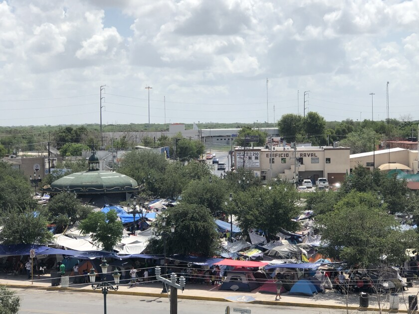 Tents and tarps crowd the Plaza Las Americas migrant camp in Reynosa, Mexico.