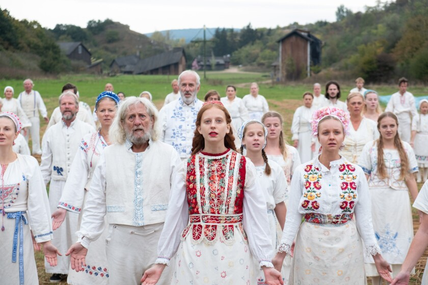 "Isabelle Grill, center, in a scene from ""Midsommar."""
