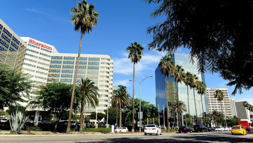 Century Boulevard near Los Angeles International Airport is crowded with hotels, most of which are owned, licensed or managed by mega-hotel companies.