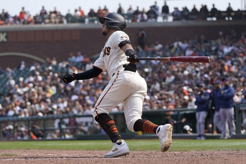 San Francisco Giants' Thairo Estrada watches his three-run home run against the Milwaukee Brewers during the eighth inning of a baseball game in San Francisco, Thursday, Sept. 2, 2021. (AP Photo/Jeff Chiu)
