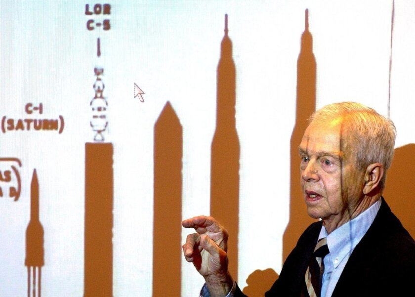 John C. Houbolt explains the size of different rockets required to land on the moon at Grainger Engineering Library at the University of Illinois in 2003.