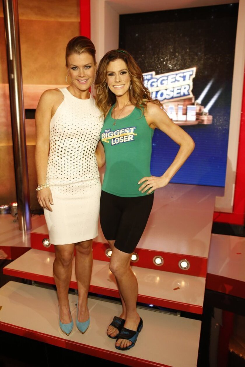 """Rachel Frederickson, right, with """"The Biggest Loser"""" host Alison Sweeney. Frederickson lost nearly 60% of her body weight during her time as a contestant."""