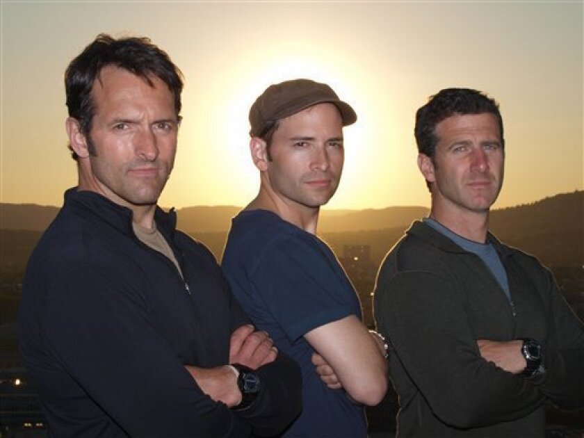"In this image released by NBC, reporters, from left, Roger Carstens, Adam Ciralsky and Scott Tyler from NBC's ""The Wanted,"" are shown on May 30, 2009. The program debuts on July 20 at 10 p.m. EDT. (AP Photo/NBC)"